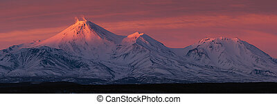 Winter panorama landscape volcanoes of Kamchatka Peninsula at sunset