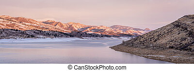 winter panorama of mountain lake at foothills of Rocky Mountains