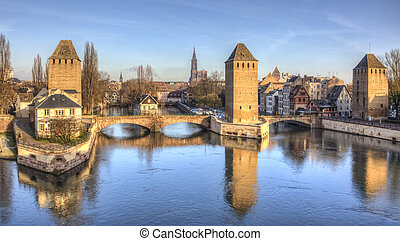 Winter panorama of the famous bridges Ponts Couverts in Strasbourg, France.