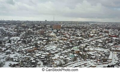 Winter panoramic aerial view of cityscape of Dnipro city....