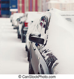 Winter parking, cars in the snow