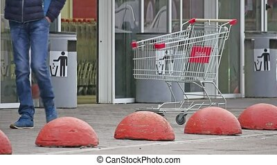 winter people go to the supermarket market door opens, shop...