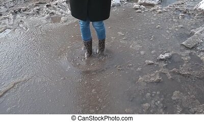 People in boots in a puddle in winter - Winter. People in...