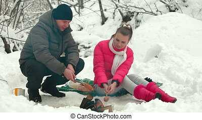 Winter Picnic By Bonfire in Snow