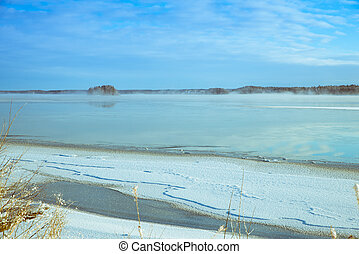 Winter picture of a lake with ice on