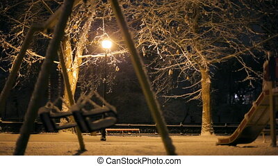 Winter playground - Empty playground strewn with snow.