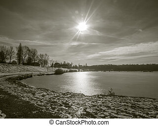 Winter pond with sun in vintage style