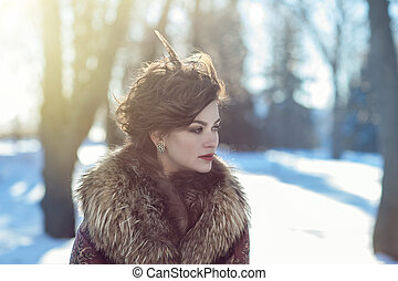 Winter portrait of a girl in fur clothing