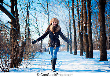 Winter portrait of a girl outdoors in the forest