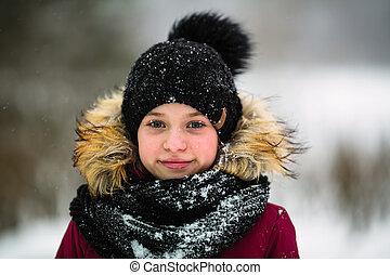 Winter portrait of a little girl outdoor.