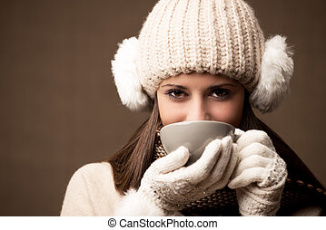 Winter - Portrait of beautiful winter woman with a cup of ...