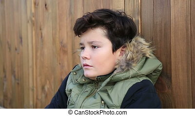 Winter portrait of cute boy in warm clothes