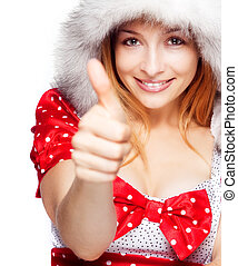 Winter portrait of joyful woman showing ok sign