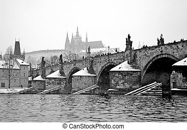 Winter Prague - B/W view from river to Charles bridge and ...