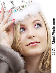 winter queen - closeup portrait of lovely blond in fur and...