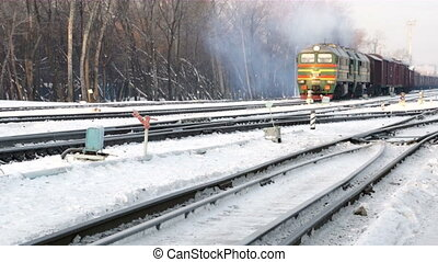 winter rail road with cargo locomotive