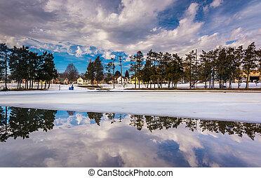 Winter reflections at Kiwanis Lake, in York, Pennsylvania. -...