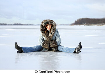 winter rest - young woman sits on the ice