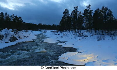 Winter River - Fast river flowing in the nordic winter