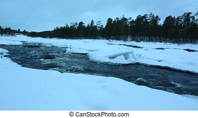 Winter River Flow - Fast river flowing in the nordic winter