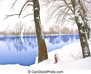Winter river in snowy day