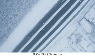 Winter road follow - Winter road top down view with cars and...