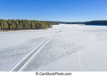 Winter road on lake drone photo