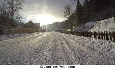 Winter road in village