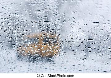 winter road through wet windshield