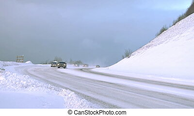Winter Road Traffic Snowy Highway - Several vehicles being...