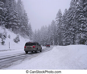 Winter landscape with snow road, cars and forest