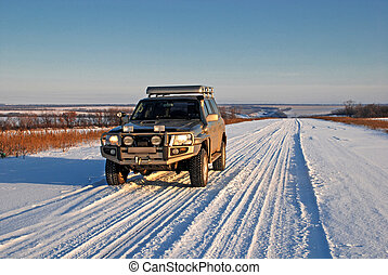 winter road with car 4x4 - snow road with car 4x4 in sunny...