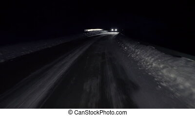 Winter road with snow. First person point of view looking...
