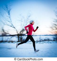 Winter running - Young woman running outdoors