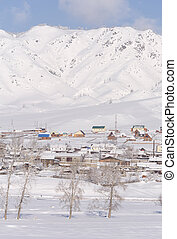 Winter rural landscape in Siberia. The village in the Altai mountains.