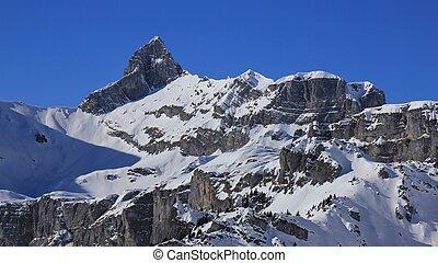 Winter scene in the Swiss Alps. Hoch Turm, mountain peak in Braunwald.