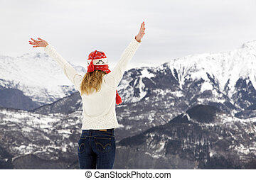 winter scene: blond girl on the top of a mountain. Copy...