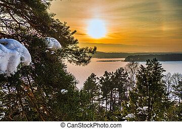 Winter Scene with Golden Sunset over Frozen Lake