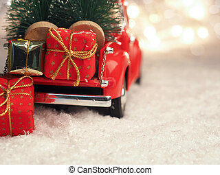 Winter scene with red Christmas truck and gift boxes