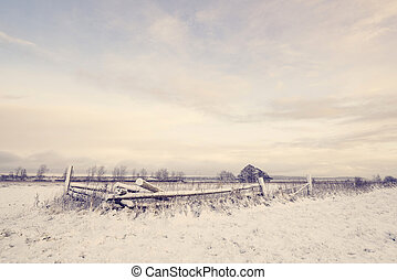 Winter scenery with a wooden fence