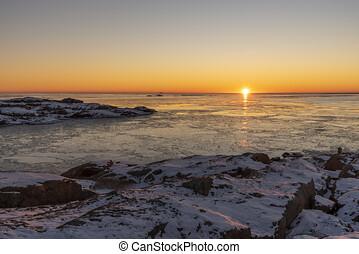 Winter sea in sunset in Sweden
