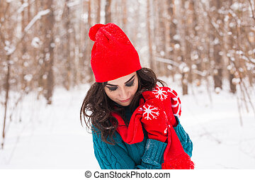 Winter, season and people concept - Close up portrait of young pretty woman walking in snowy park