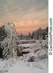 Winter season landscape - Sunset on an unfrozen lake in the...