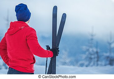 Skier with Skis in Hand - Winter Season Sports Theme....