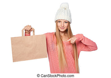 Winter shopping concept. Happy woman wearing knit hat and...