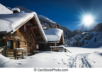 winter ski chalet and cabin in snow mountain landscape in ...
