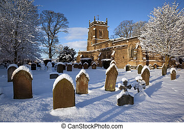 Winter snow in a village churchyard