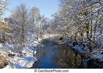 Winter snow Irfon river in Llangammarch Wells, Wales UK.