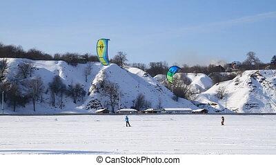 Winter Snow kiting on the ice lake