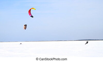 Winter Snow kiting on the ice lake